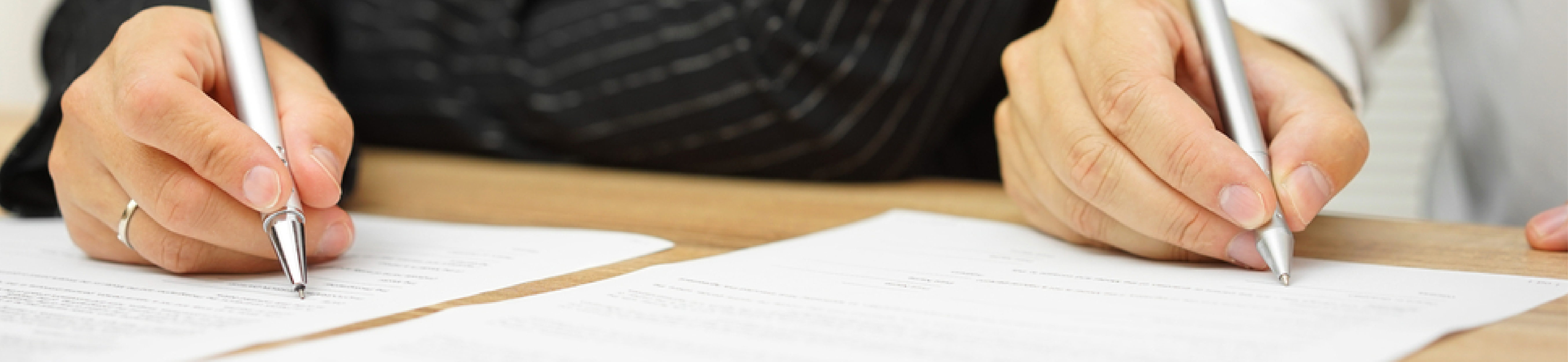Parents sign a child custody agreement